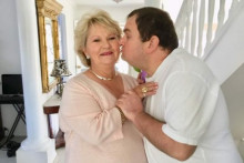 Sam kisses his mother, Cheryl, on the cheek.