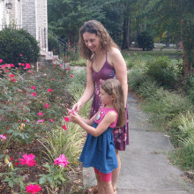 mother and daughter wearing summer clothes on a garden path