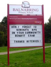 """Balnarring Public School, sign saying """"don't forget to nominate BPS on your community benefits card - Thanks Richies"""""""