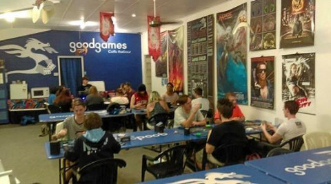 room full of young people sitting at tables playing games